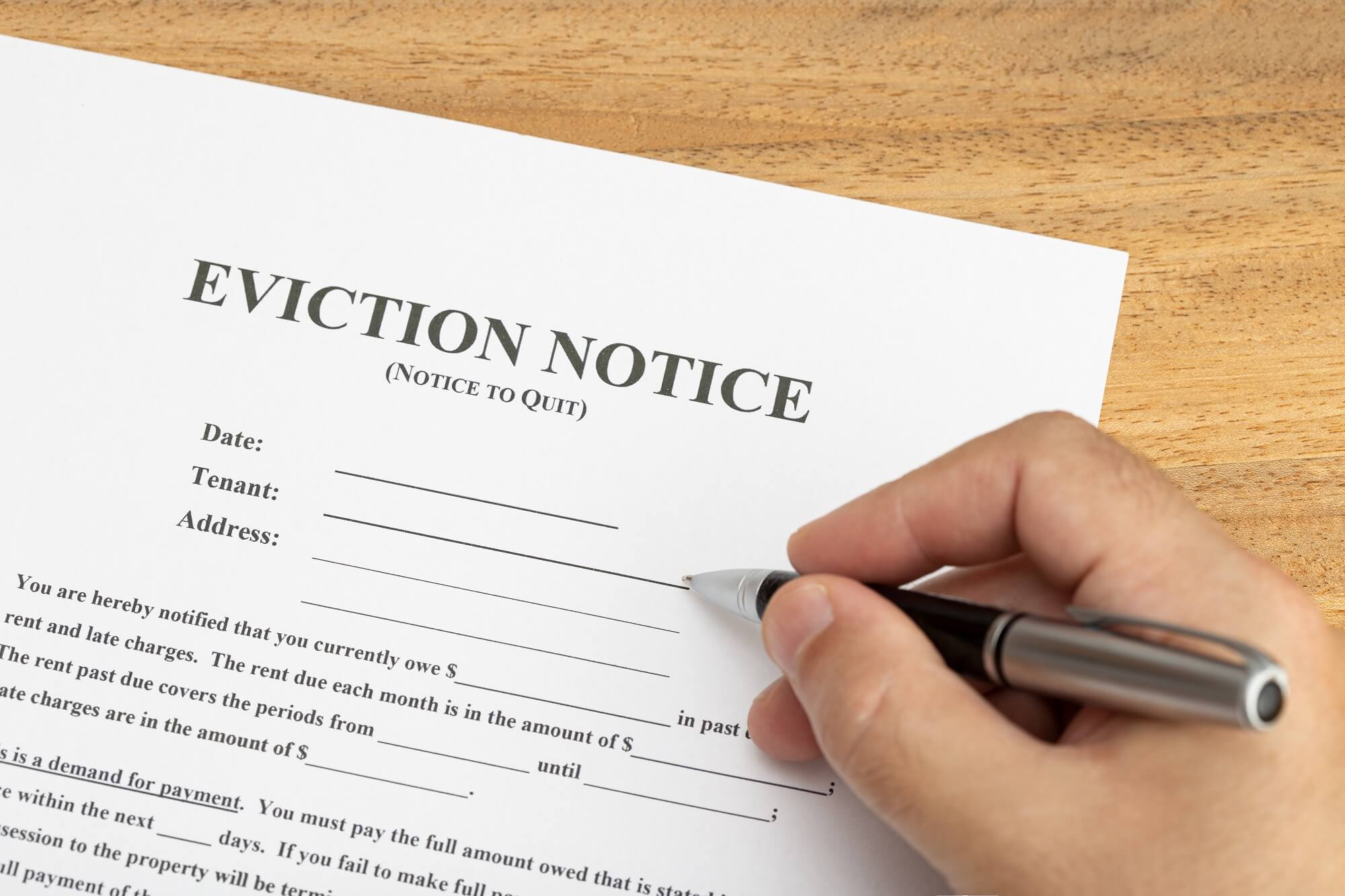 hand ready to fill a eviction notice document 5ZW572L 1